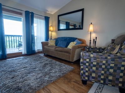 Family room with private deck, free Wi-Fi, and large cable television