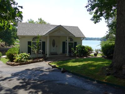 Beautiful lake cottage with deck extending over the water.  No stairs to climb