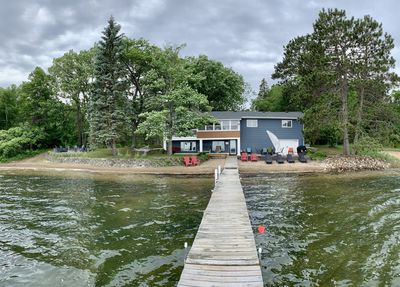 Panoramic view of 200 feet of pristine lake shore, fire pit and lakeside decks.