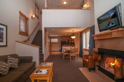 This spacious condo has a wood-burning fireplace and a large private balcony.