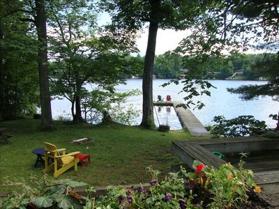 Firepit, Lake Muskoka and dock as seen from deck, facing south.