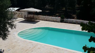 Photo for Wonderful private trullo with pool and outbuilding, in free WiFi olive grove