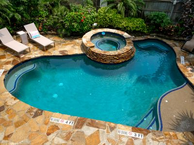 Photo for Charming Beach House private oasis - heated pool and hot tub