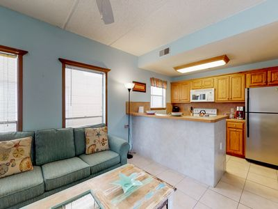 Photo for Beautiful family condo with full kitchen and free WiFi - steps from the beach!