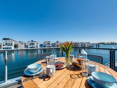Photo for The Nordic House: sea view, roof terrace, boat launch, beach chair, sauna
