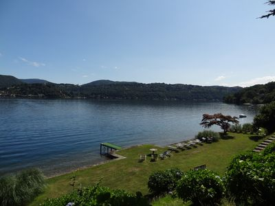 Photo for Charming Villa with secular park in front of the lake. Free canoes, bikes, bbq ...