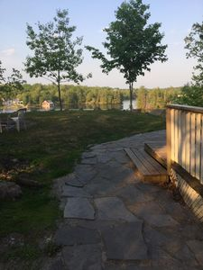 New Landscaping details: stone walkway, flat lawn area to relax and enjoy the firepit and the spectacular lake view