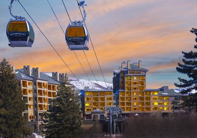 Gondola comes right to your door, connects with another lift.   Ski/boot valet!