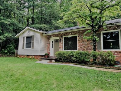 "Photo for ""Guesthouse"" Cozy home with a wonderful wooded and private backyard."