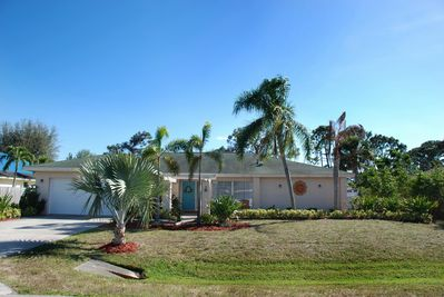 Beautiful wide double Lot with Tropical Landscaping and ample Parking