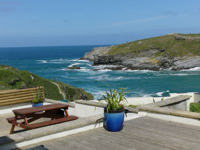 Photo for Surfside superb beach front home above Porth Beach- pets welcome
