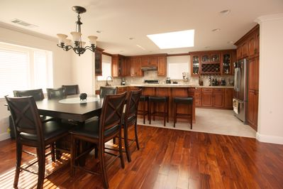Spacious and elegant, open-concept kitchen with a large eat-in island