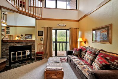 Cozy living room with sleeper sofa, sliding door to balcony and gas fireplace