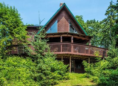 This two-story cabin in the woods is professionally managed by TurnKey Vacation Rentals.