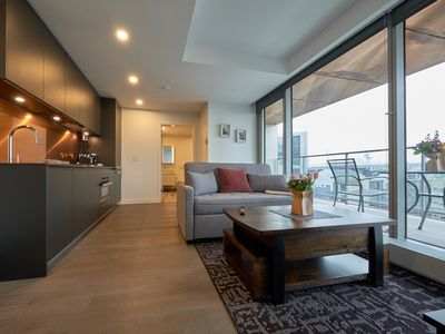 Photo for Amazing new 1 bdrm condo with view pool hot tub gym large deck 2 min to seawall