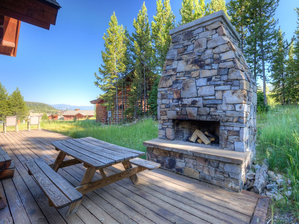 Beautiful log cabin with large outdoor fireplace ski for Log cabin with hot tub one night stay