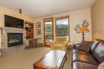 Living area with private balcony facing the mountain and ski slopes