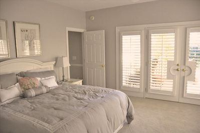 The master suite, with access to the back deck.  Note the plantation shutters!