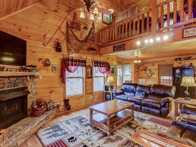 Photo for Cozy log cabin w/private hot tub, shared seasonal pool, and jetted tub