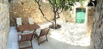 Photo for Cozy stone house with 3 terraces by the sea, all within walking distance