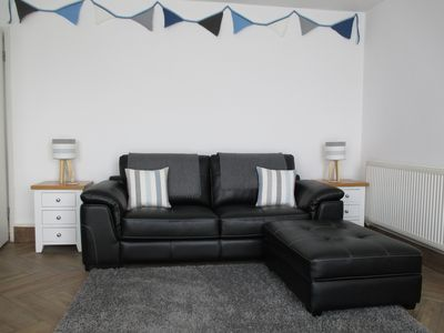 Lounge/diner with comfy sofa