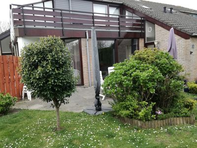 Photo for Sunny holiday home near Grevelingenmeer with enclosed garden + spacious terrace.