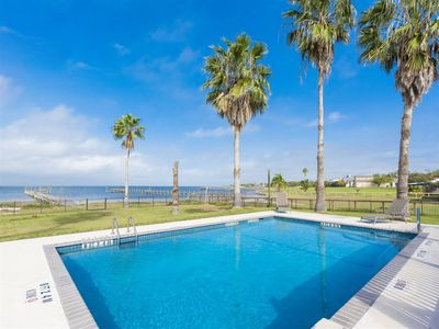 Photo for Awesome 5 bedroom, 3.5 bath bay front home with private swimming pool and 270 ft private, lighted fi