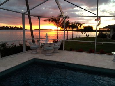 Photo for WATCH THE DOLPHINS! LUXURY HOME WITH LARGE POOL AND WIDE WATER VIEW!