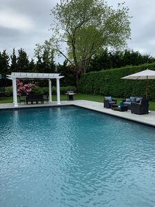 Pool area with lounge chairs and Viking propane grill