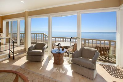 Living Area - Wall-to-wall windows boast incredible views of Monterey Bay from the main living area.