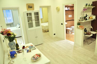 The living and dining area with a view of the two double bedrooms and bath