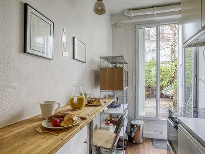 Photo for Hidden Abode with Large Patio in Buttes-Chaumont