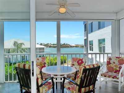 Photo for Tranquil waterfront condo w/ heated pool, hot tub & short walk to Esplanade