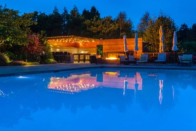 Outdoor kitchen and firepit at night