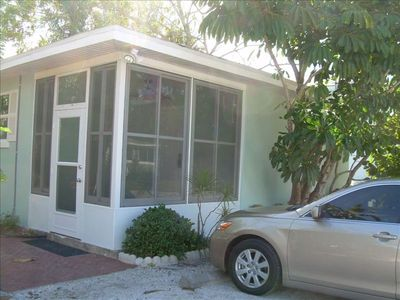 Lanai with sliding  screened windows, perfect bug free dining any time day/nite!