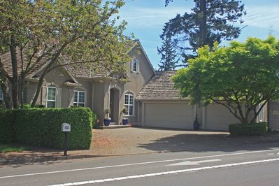 Front view of the property; private driveway parking.