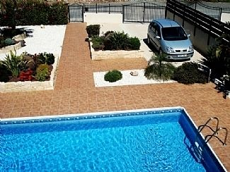 View of pool and front garden