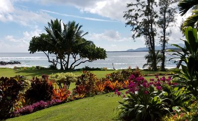 View from your lanai of the meticulous grounds at Lae Nani, on the Wailua Bay.