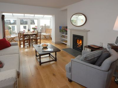 Photo for Grade II former coastguard's cottage is a fresh and bright beach retreat