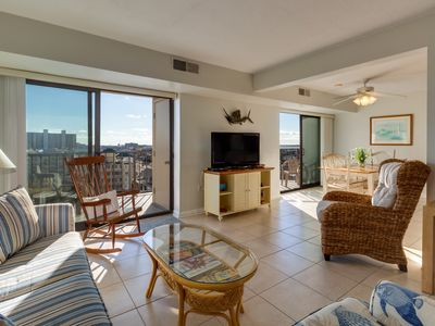 Photo for NEW LISTING! Beautiful water view condo with shared pool, sundeck & gym