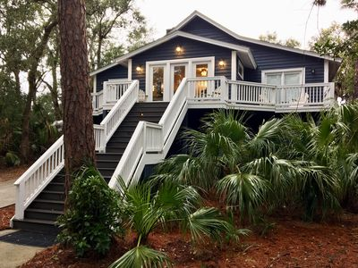 Photo for 6 bedroom 5 baths sleeps 12! Private dock on the canal. Steps from the beach!