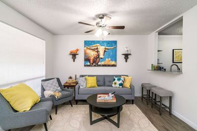 Bright colors and large living-room  window provide lots of light in the cute abode!