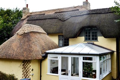 Rear of cottage showing conservatory