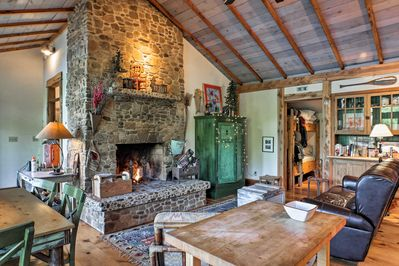 Throw a log on the wood-burning fireplace and settle into the cabin.