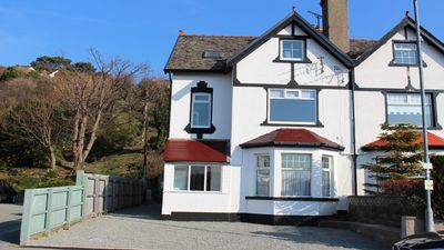 Photo for 4 Bedroom Apartment with Stunning Sea views. Sleeps 9. Short walk to beach,