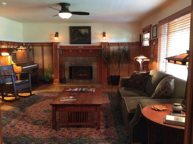 Amber glows from the mica lamps; 1930's Pasadena tiles surround the fireplace...