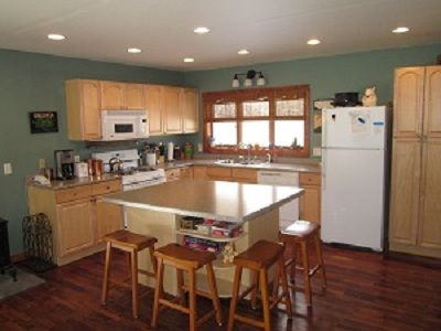 Spacious kitchen with an island that seats four.