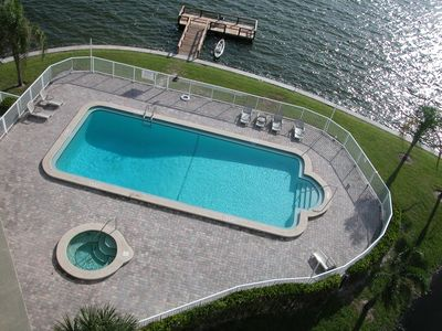 Spacious pool and relaxing hot tub with stunning views of the Intercoastal