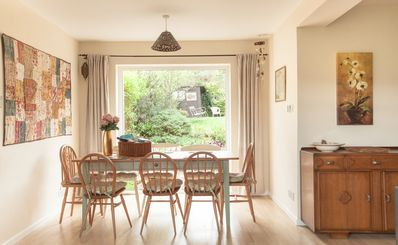 light filled dining area seats 8 with views to the back and front gardens