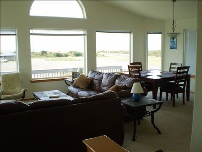 Enjoy the view of the Pacific Ocean from the open living room and kitchen
